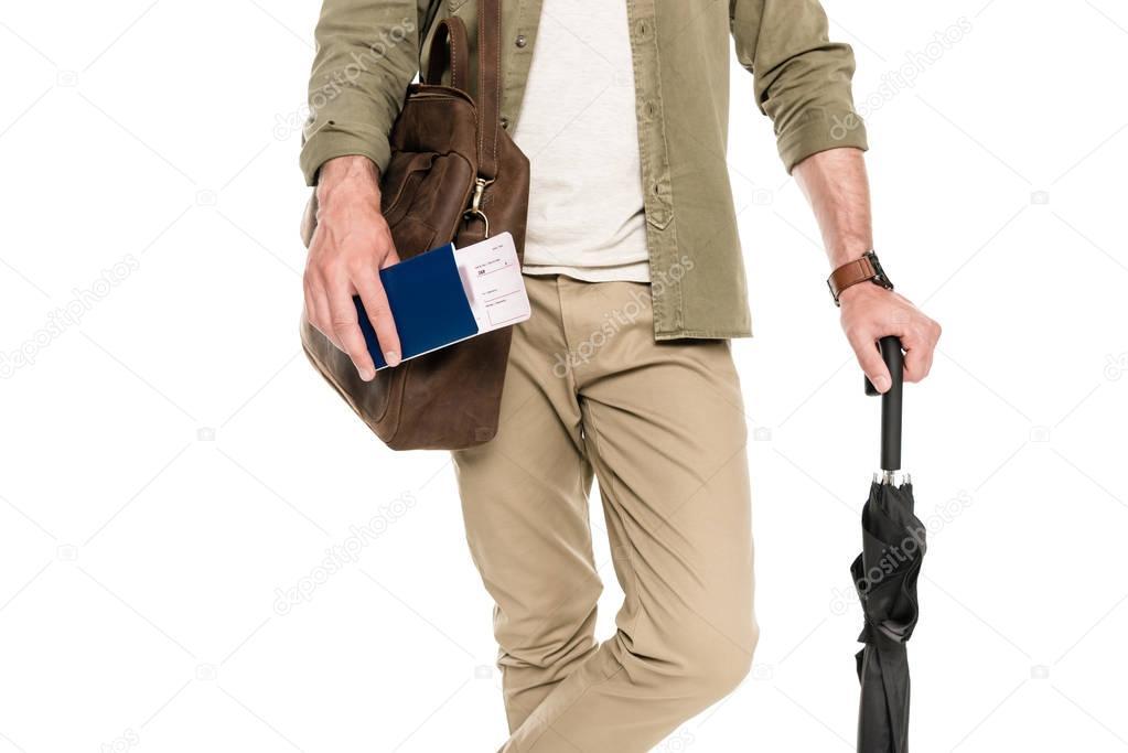 tourist with passport, tickets and umbrella