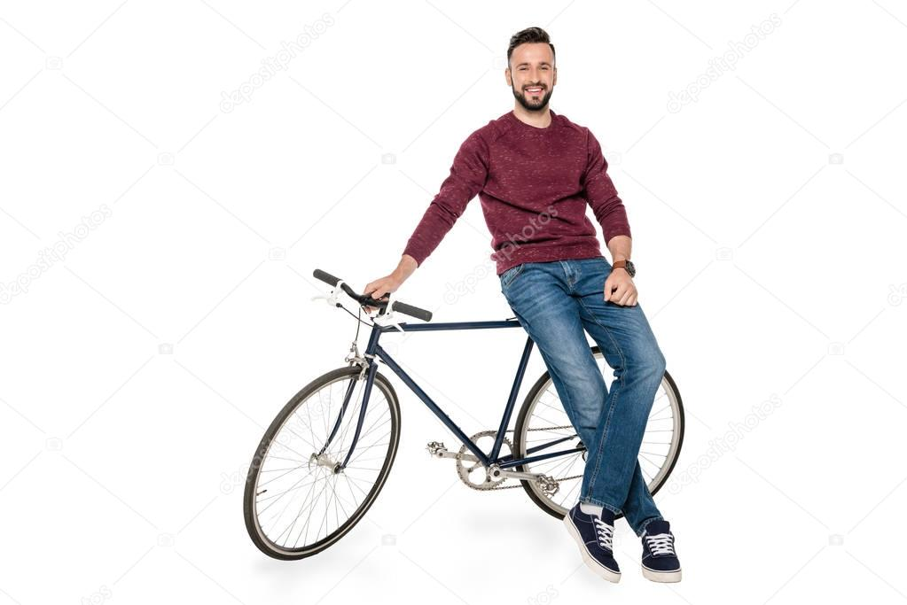 man leaning on bicycle