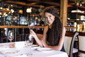 caucasian woman with wine in restaurant