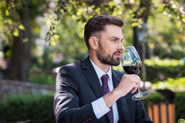 caucasian man with wine in restaurant