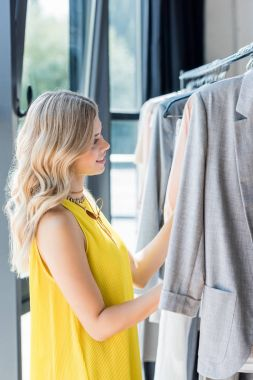 woman choosing clothes in store