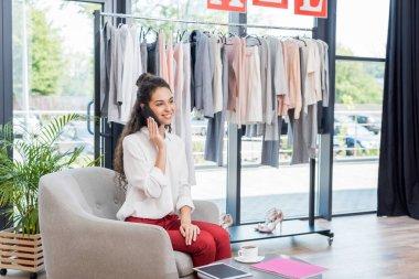 woman talking by phone in showroom