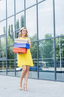 blonde woman with shoe boxes
