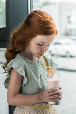 Girl drinking milkshake