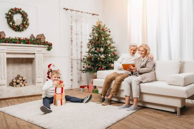 grandparents and grandson with gift boxes