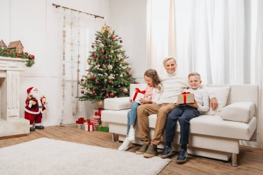 grandfather and kids with christmas gifts