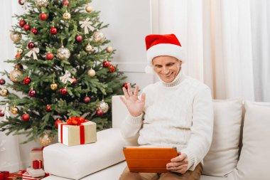 man making video call on christmas