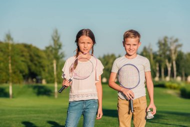 kids with badminton equipment