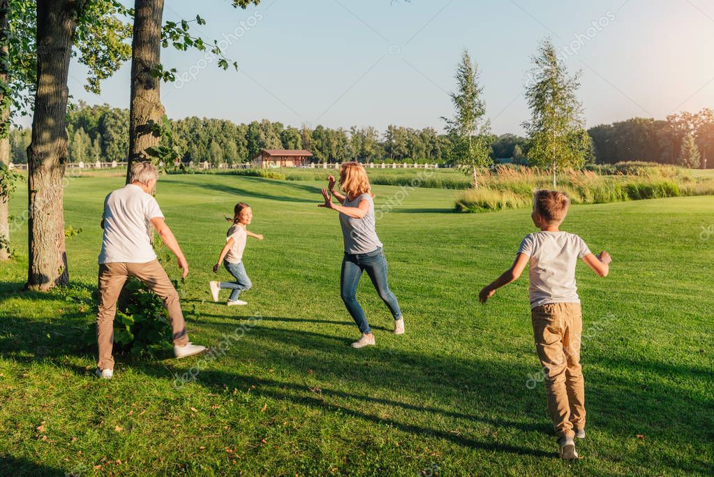 Family running on meadow