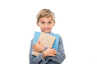 happy schoolboy holding books