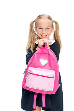 excited schoolgirl with pink backpack