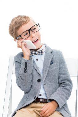 schoolboy talking by phone