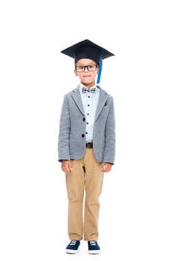 happy schoolboy in graduation hat
