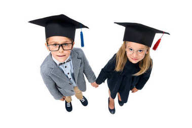 pupils in graduation hats