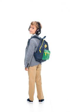 Schoolboy in wireless headphones