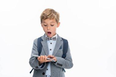 shocked schoolboy using tablet