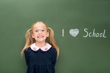 happy schoolgirl in eyeglasses