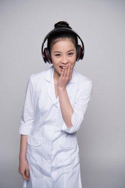 Laughing woman in headphones
