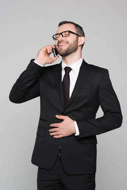 Businessman laughing and talking on phone