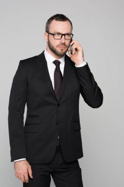 concerned young businessman talking on phone