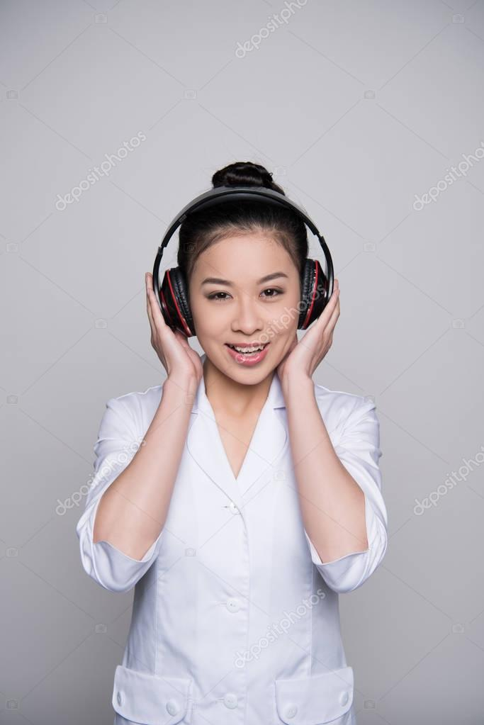 Smiling woman in headphones