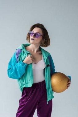 stylish woman holding ball