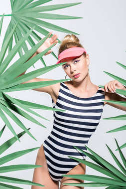 stylish young woman in swimsuit and cap