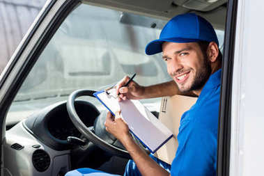delivery man filling in documents
