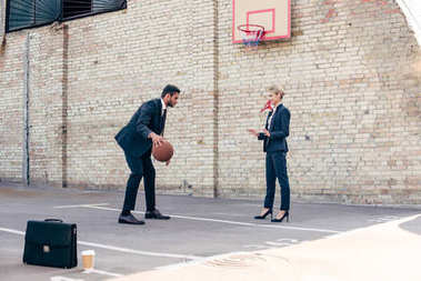 business colleagues playing basketball