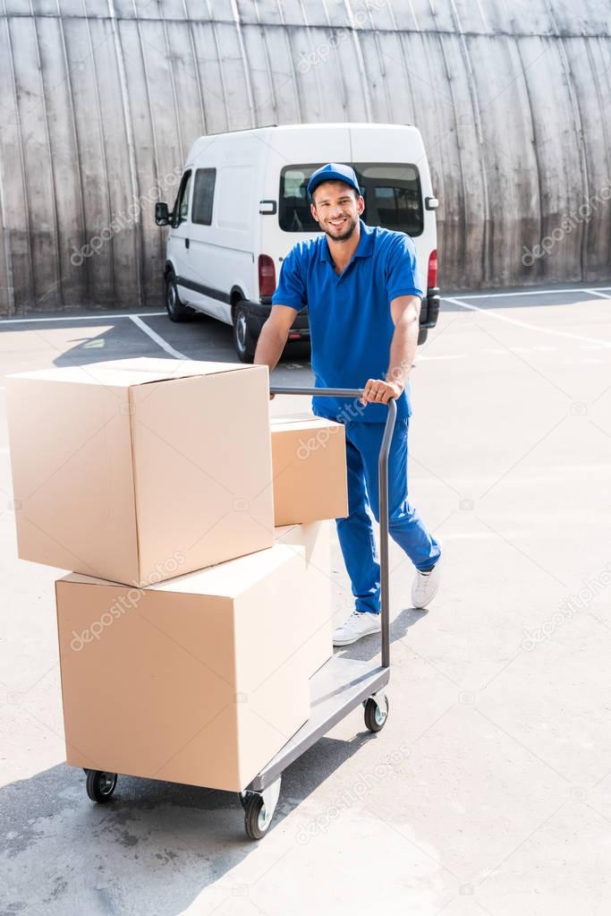 delivery man with boxes on cart