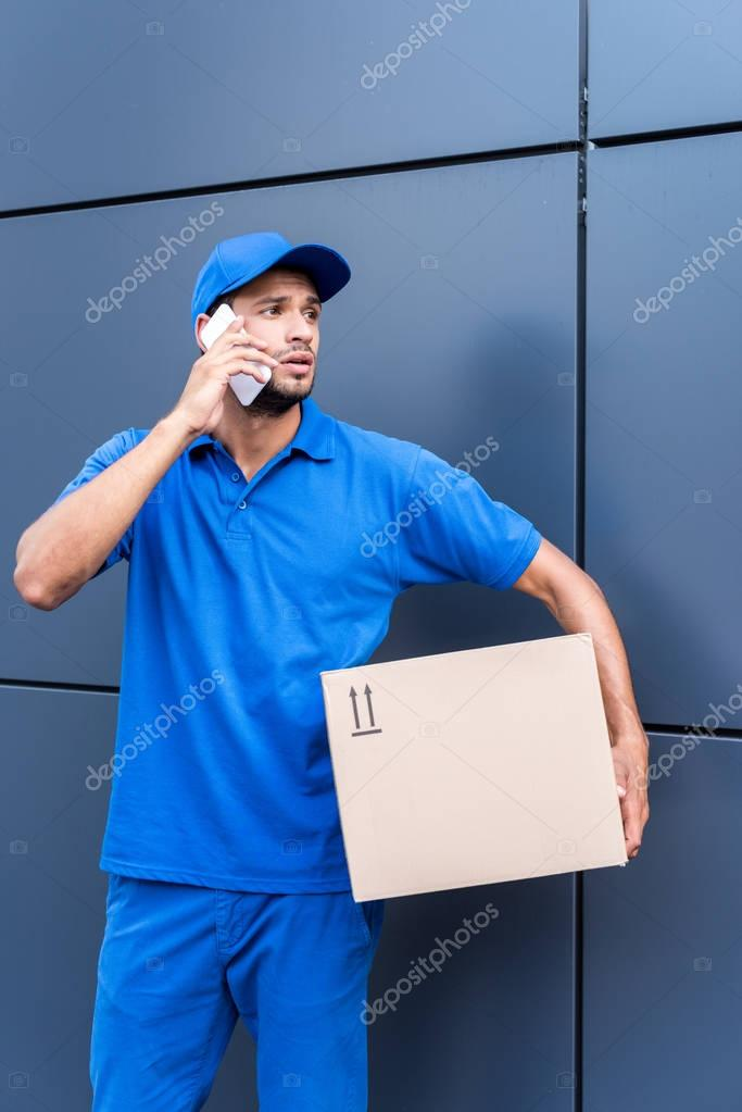 delivery man talking by phone