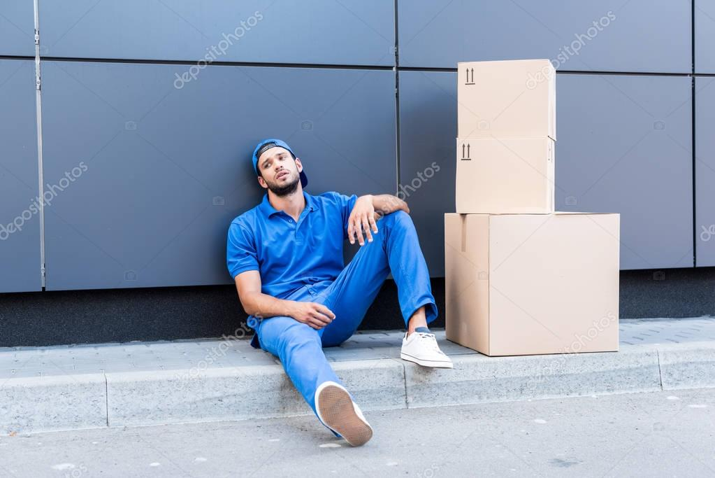 exhausted delivery man