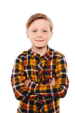 Portrait of cute little boy standing with crossed arms and smiling at camera isolated on white stock vector