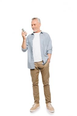 smiling senior man with smartphone