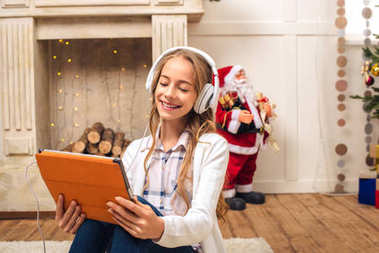 teen with digital tablet at christmastime