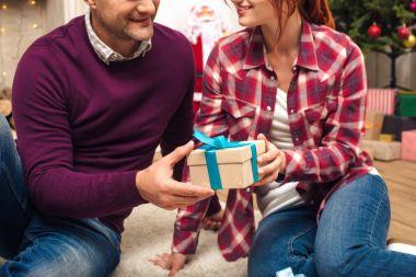 couple with christmas present