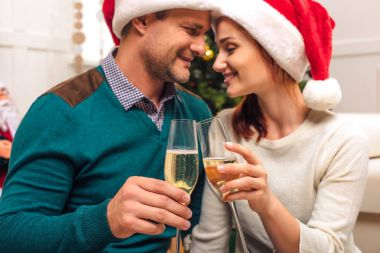 couple drinking champagne at new year