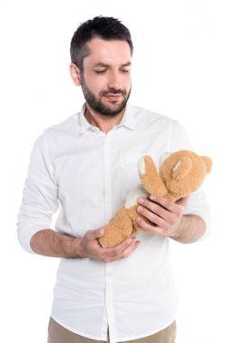 Man holding teddy bear