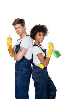 Multiethnic cleaners with cleaning supplies