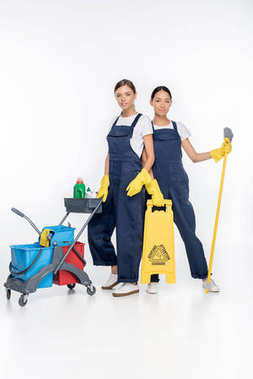 multicultural cleaners with cleaning equipment
