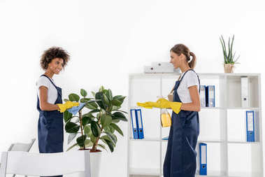 female cleaners working together