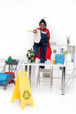 african american cleaner in superhero costume