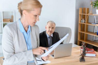 business partners doing paperwork