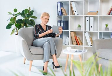 businesswoman looking at tablet in office