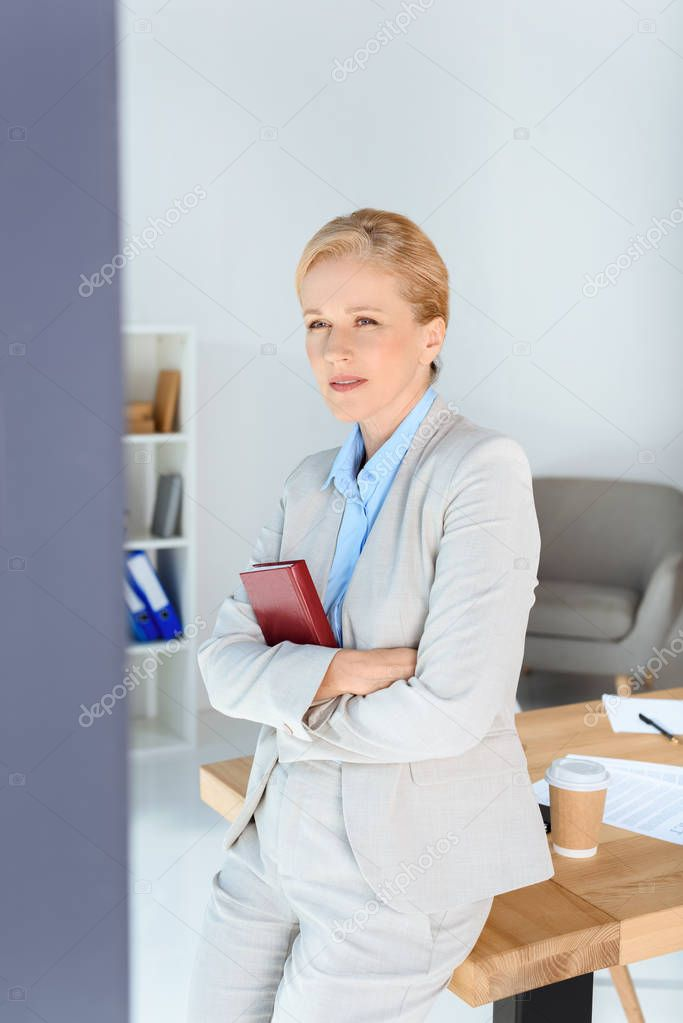 mature businesswoman with book