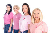 Fotografie women in pink t-shirts with ribbons