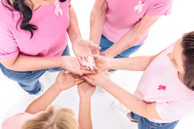women holding hands with ribbon