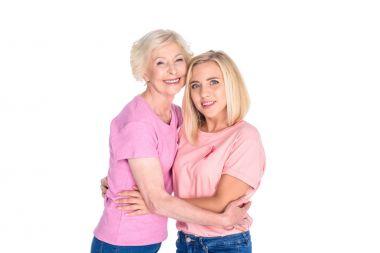 women in pink t-shirts hugging