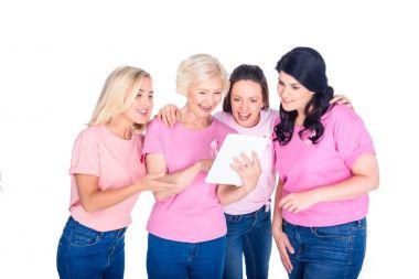 Women using digital tablet