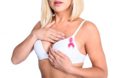 woman in bra with pink ribbon